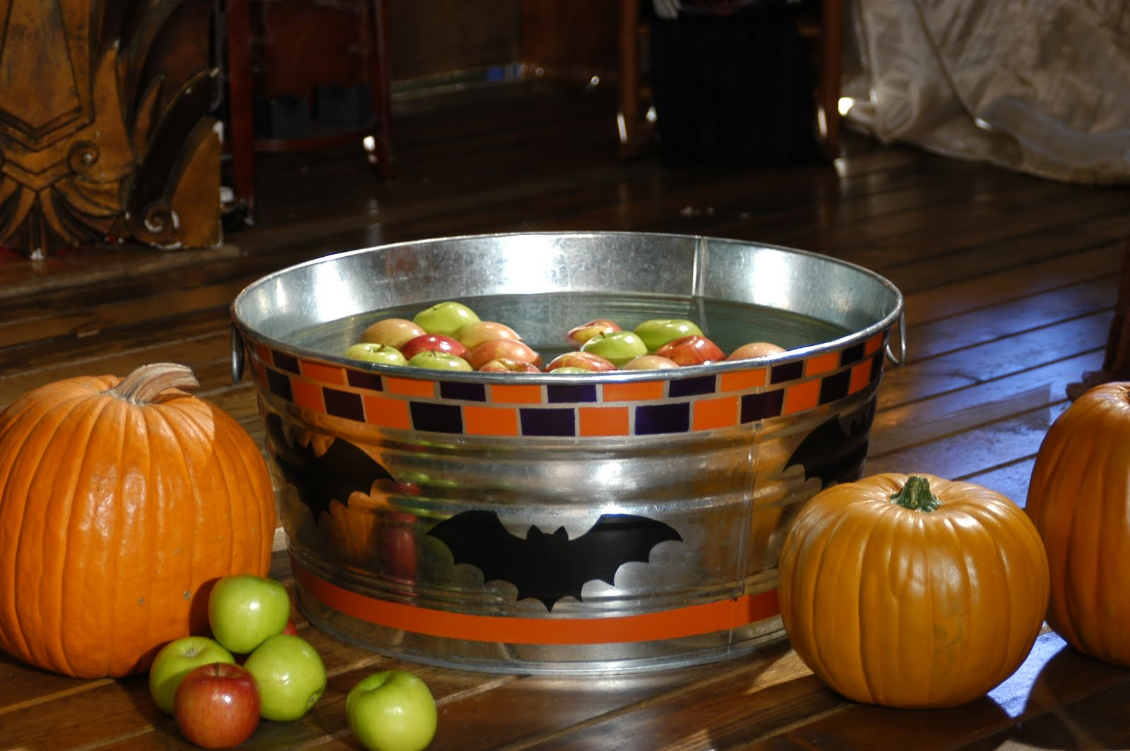 Bill Jackson http://handmadehappyhour.com/2010/10/13/halloween-witch-crafts-apple-bobbing-tub/